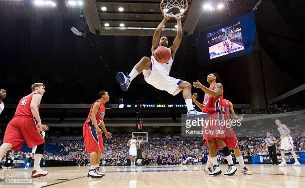 Kansas forward Marcus Morris dunks as Richmond center Dan Geriot guard Kevin Anderson forward Justin Harper and guard Darien Brothers watch in the...