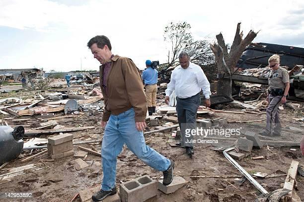 Kansas Gov Sam Brownback and Wichita Mayor Carl Brewer tour the tornadodamaged Pinaire Mobile Home Park on April 15 2012 in Wichita Kansas The storms...