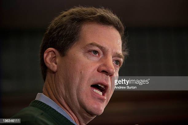 Kansas Governor Sam Brownback gives a speech supporting Texas Governor and Republican presidential candidate Rick Perry at the Hotel Pattee on...