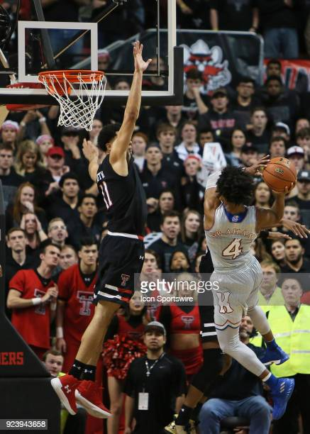 Kansas guard Devonte' Graham makes a difficult shot to put the game to bed during the No6 Texas Tech Raider's 7472 loss to the No8 Kansas Jayhawks on...