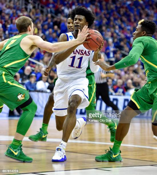 Kansas guard Josh Jackson drives to the basket against Oregon's Casey Benson in the first half during the NCAA Tournament's Midwest Region final at...