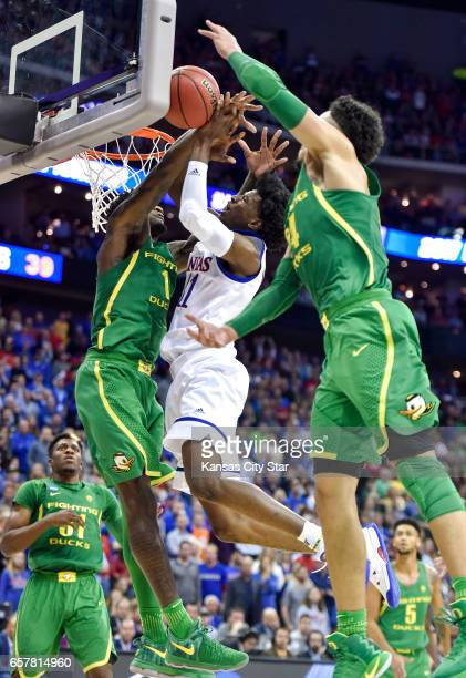 Kansas guard Josh Jackson has his shot blocked by Oregon forward Jordan Bell in the second half during the NCAA Tournament's Midwest Region final at...