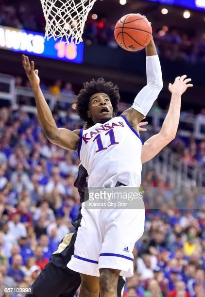 Kansas guard Josh Jackson pulls down a rebound against Purdue in the Sweet Sixteen round of the NCAA Tournament at Sprint Center in Kansas City, Mo.,...