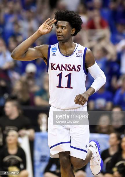 Kansas guard Josh Jackson signals three for his 3point basket in the first half against Purdue during the Sweet Sixteen round of the NCAA Tournament...