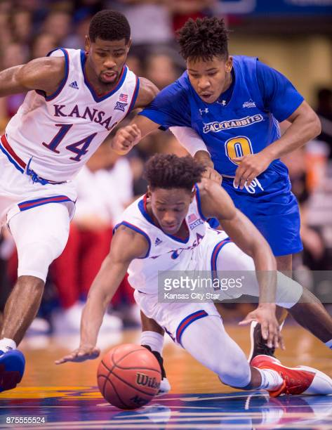 Kansas guard Malik Newman and South Dakota State guard Brandon Key battle for position as Kansas guard Marcus Garrett dives for a loose ball in the...