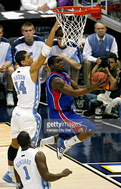 Kansas guard Sherron Collins scores under North Carolina guard/forward Danny Green The Jayhawks defeated the Tar Heels 8466 during a semifinal game...