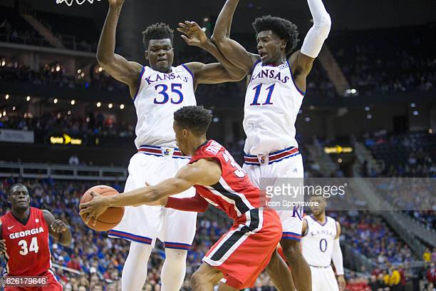Kansas Jayhawks center Udoka Azubuike and Kansas Jayhawks guard Josh Jackson block Georgia Bulldogs forward Connor O'Neill during the NCAA CBE Hall...