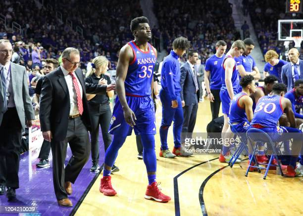 Kansas Jayhawks center Udoka Azubuike limps off the court in the first half of a Big 12 basketball game between the Kansas Jayhawks and Kansas State...