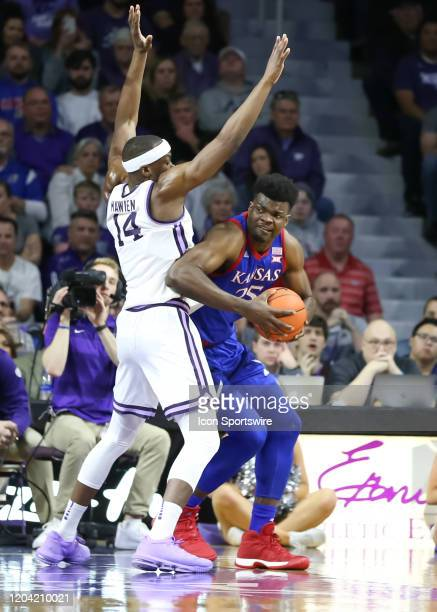 Kansas Jayhawks center Udoka Azubuike looks to get around Kansas State Wildcats forward Makol Mawien in the first half of a Big 12 basketball game...