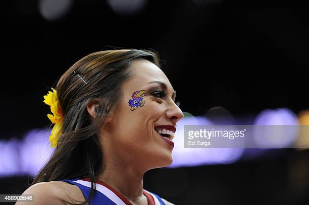 Kansas Jayhawks cheerleader performs during a game against the Baylor Bears during the semifinals round of the Big 12 basketball tournament at Sprint...