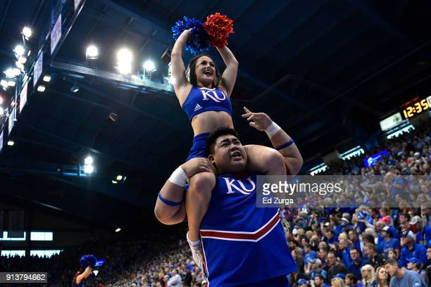 Kansas Jayhawks cheerleaders entertain during a game against the Oklahoma State Cowboys at Allen Fieldhouse on February 3 2018 in Lawrence Kansas