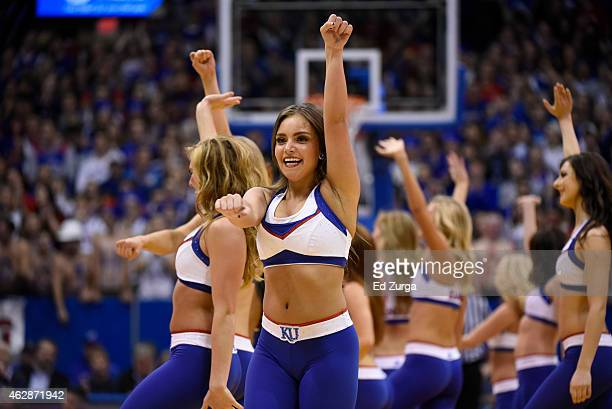 Kansas Jayhawks cheerleaders perform during a game against the Iowa State Cyclones at Allen Field House on February 2 2015 in Lawrence Kansas