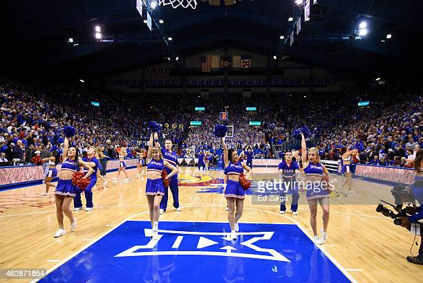 Kansas Jayhawks cheerleaders perform during a game between Iowa State Cyclones and Kansas Jayhawks at Allen Field House on February 2 2015 in...