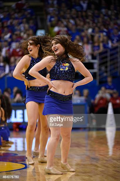 Kansas Jayhawks cheerleaders performs during a game against the Baylor Bears at Allen Fieldhouse on February 14 2015 in Lawrence Kansas