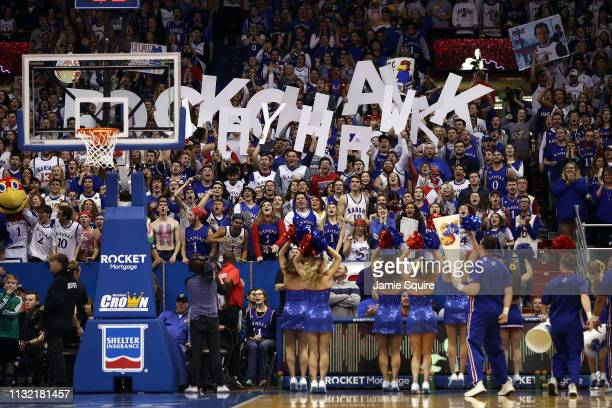 Kansas Jayhawks fans cheer during the game against the Kansas State Wildcats at Allen Fieldhouse on February 25 2019 in Lawrence Kansas