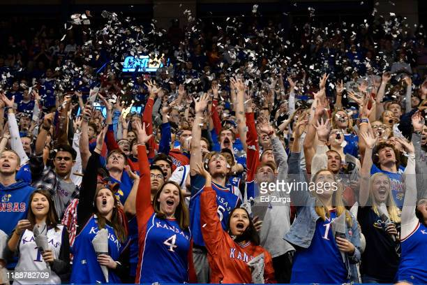 Kansas Jayhawks fans cheer for their team prior to a game against the East Tennessee State Buccaneers during the first half at Allen Fieldhouse on...