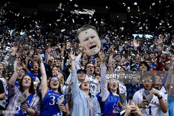 Kansas Jayhawks fans cheer on their team as they are introduced prior to a game against the TCU Horned Frogs at Allen Fieldhouse on February 6 2018...