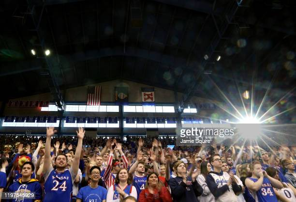 Kansas Jayhawks fans cheer prior to the start of the game against the West Virginia Mountaineers at Allen Fieldhouse on January 04, 2020 in Lawrence,...