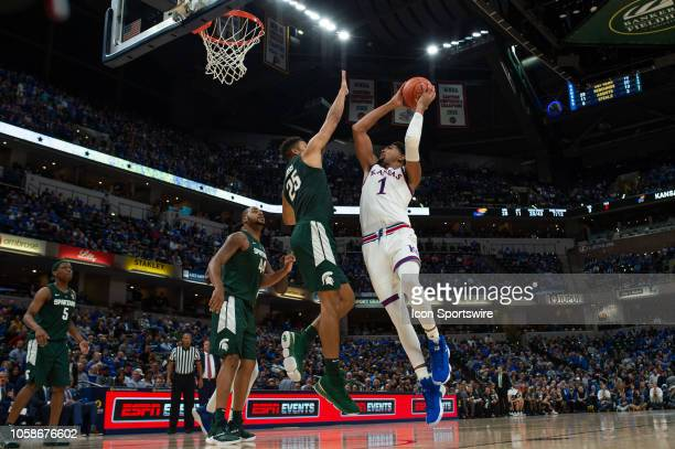 Kansas Jayhawks forward Dedric Lawson scores inside against Michigan State Spartans forward Kenny Goins during the State Farm Champions Classic...