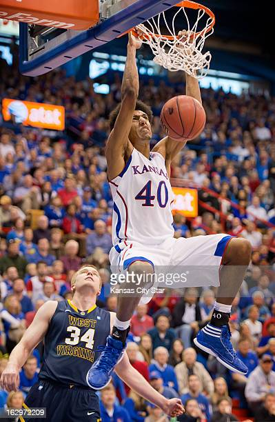 Kansas Jayhawks forward Kevin Young dunks over West Virginia Mountaineers forward Kevin Noreen in the second half at Allen Fieldhouse in Lawrence...