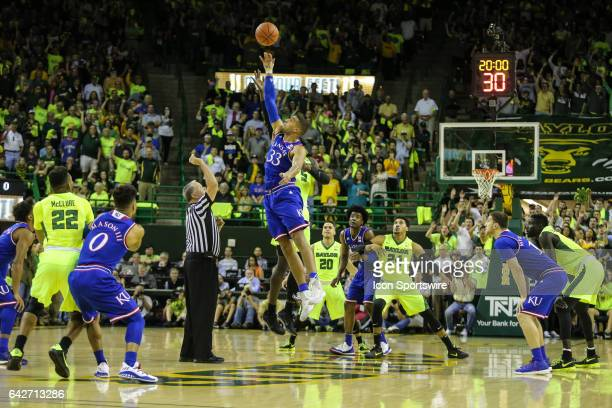 Kansas Jayhawks forward Landen Lucas gets the tip-off to start the men's basketball game between Baylor and Kansas on February 18 at the Ferrell...