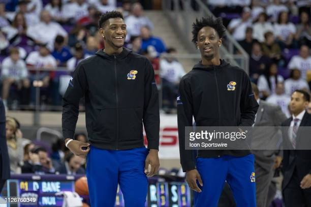Kansas Jayhawks forward Silvio De Sousa and guard Marcus Garrett look on during the Big 12 college basketball game between the TCU Horned Frogs and...