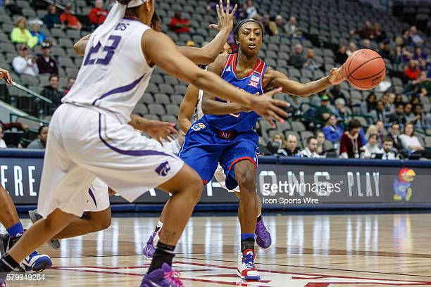 Kansas Jayhawks guard Chayla Cheadle makes a pass during the NCAA Big 12 Women's basketball tournament game between the Kansas Jayhawks and the...