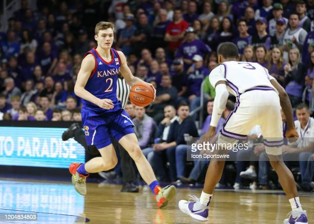 Kansas Jayhawks guard Christian Braun brings the ball up court in the second half of a Big 12 basketball game between the Kansas Jayhawks and Kansas...