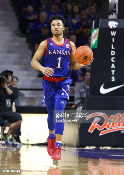 Kansas Jayhawks guard Devon Dotson brings the ball up court in the second half of a Big 12 basketball game between the Kansas Jayhawks and Kansas...
