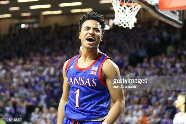 Kansas Jayhawks guard Devon Dotson yells in celebration after scoring and getting fouled in the second half of a Big 12 basketball game between the...