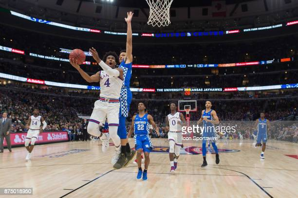 Kansas Jayhawks guard Devonte Graham scores in front of Kentucky Wildcats forward Kevin Knox on a fast break during the State Farm Champions Classic...
