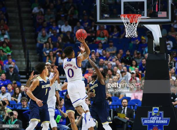 Kansas Jayhawks Guard Frank Mason III elevates over UC Davis Aggies Guard Darius Graham for the floater shot during the first round of the NCAA...