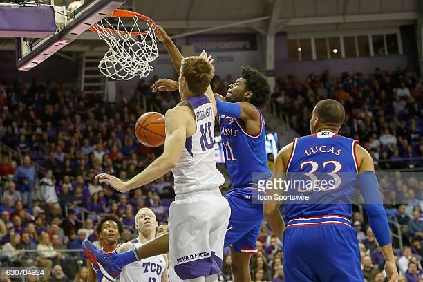 Kansas Jayhawks guard Josh Jackson dunks the ball past TCU Horned Frogs forward Vladimir Brodziansky during the NCAA Big12 game between the Kansas...