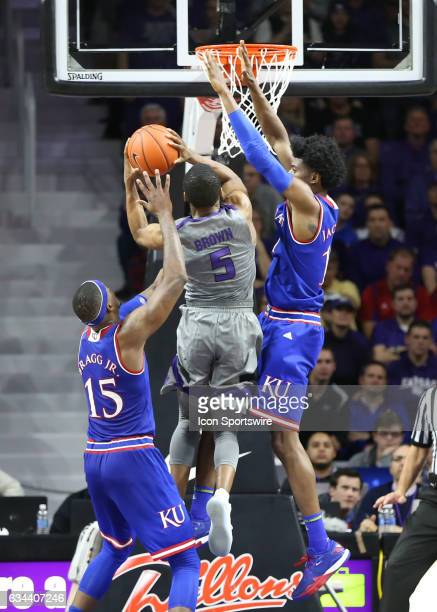 Kansas Jayhawks guard Josh Jackson goes high to defend Kansas State Wildcats guard Barry Brown in the second half of the Big 12 showdown between the...