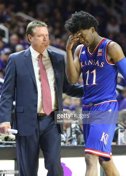 Kansas Jayhawks guard Josh Jackson heads to the bench after a blow to his head in the second half of the Big 12 showdown between the Kansas Jayhawks...