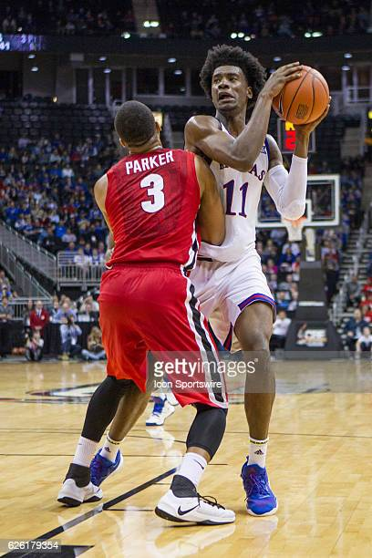 Kansas Jayhawks guard Josh Jackson is blocked out during the NCAA CBE Hall of Fame Classic Tournament game between the Kansas Jayhawks and the...