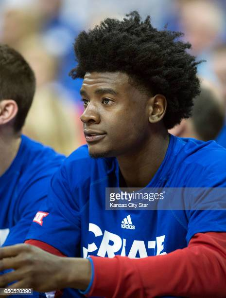 Kansas Jayhawks guard Josh Jackson watches from the bench while serving a one game suspension during the Univeristy of Kansas and TCU quarterfinal...