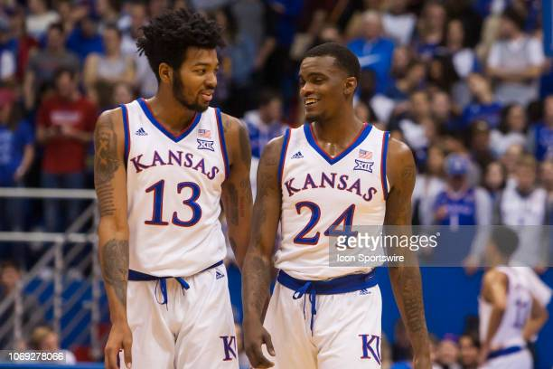 Kansas Jayhawks guard Lagerald Vick and Kansas Jayhawks guard KJ Lawson briefly speak with each during the game between the Wofford Terriers and the...