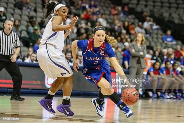 Kansas Jayhawks guard Lauren Aldridge drives the ball around Kansas State Wildcats guard Haley Texada during the NCAA Big 12 Women's basketball...