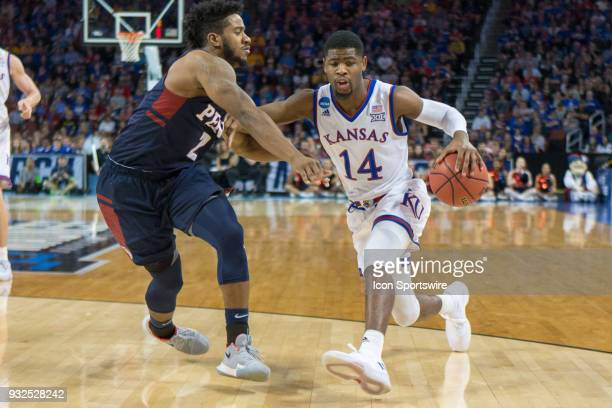 Kansas Jayhawks guard Malik Newman drives around Pennsylvania Quakers guard Antonio Woods during the NCAA Tournament first round game on March 15...