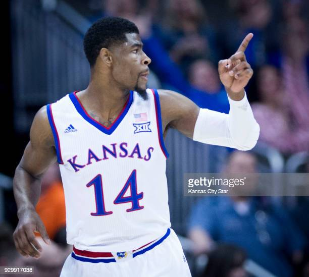 Kansas Jayhawks guard Malik Newman points to Kansas Jayhawks guard Devonte' Graham after scoring a threepointer in the first half against Kansas...