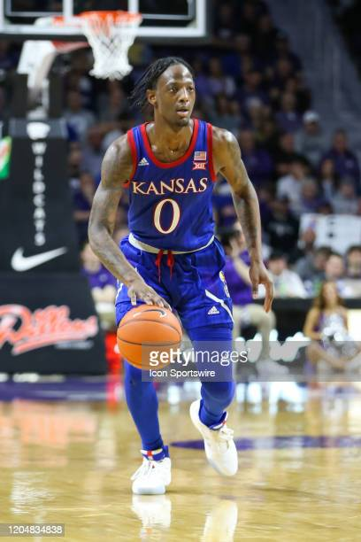 Kansas Jayhawks guard Marcus Garrett brings the ball up court in the second half of a Big 12 basketball game between the Kansas Jayhawks and Kansas...