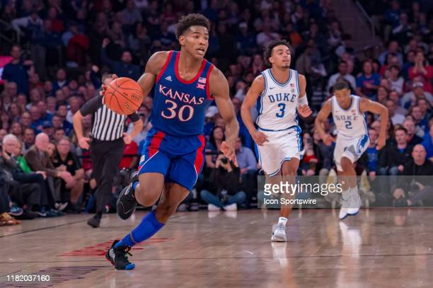 Kansas Jayhawks guard Ochai Agbaji brings the ball up court during the State Farm Champions Classic game between the Kansas Jayhawks and Duke Blue...