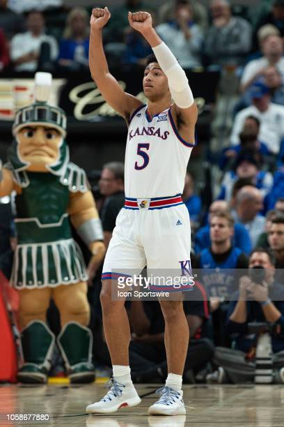 Kansas Jayhawks guard Quentin Grimes signals the sidelines during the State Farm Champions Classic basketball game between the Michigan State...