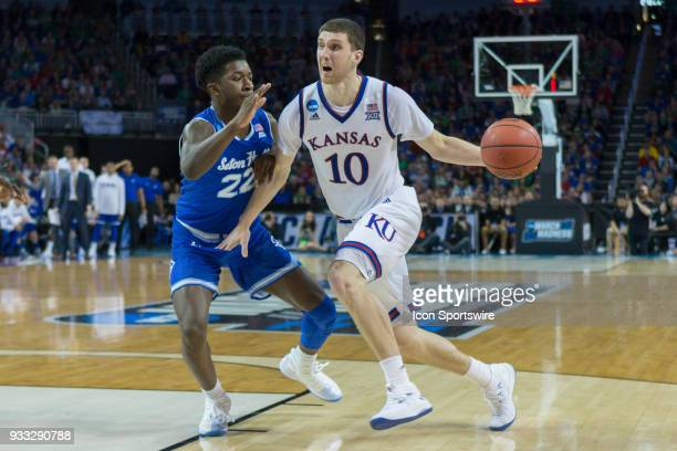 Kansas Jayhawks guard Sviatoslav Mykhailiuk drives past Seton Hall Pirates guard Myles Cale during the NCAA tournament second round game on March 17...