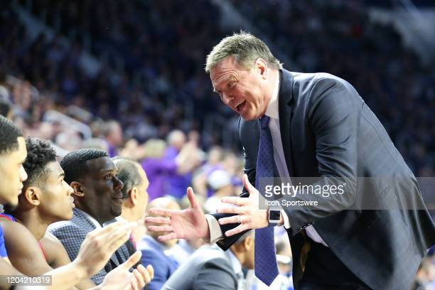 Kansas Jayhawks head coach Bill Self is animated as he talks with guard Devon Dotson on the bench in the first half of a Big 12 basketball game...