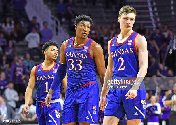 Kansas Jayhawks players Devon Dotson, David McCormack and Christian Braun walks up the court during the second half against the Kansas State Wildcats...