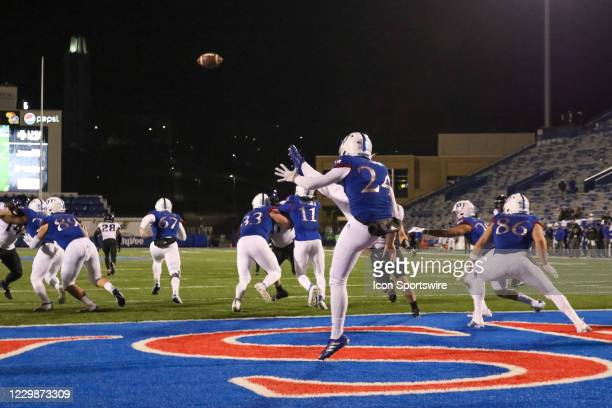 Kansas Jayhawks punter Reis Vernon kicks from the end zone in the second quarter of a Big 12 game between the TCU Horned Frogs and Kansas Jayhawks on...