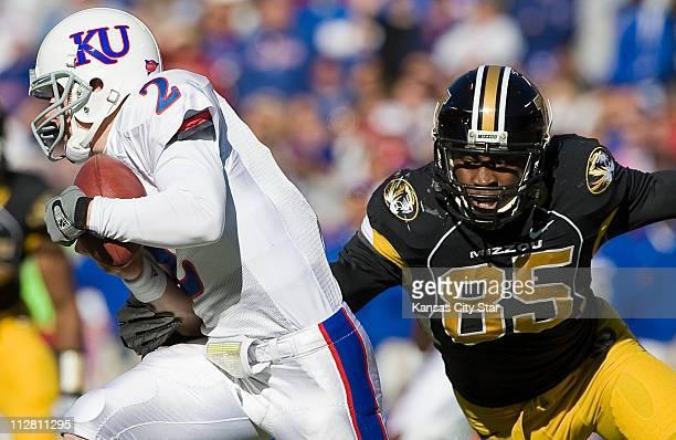 Kansas Jayhawks quarterback Jordan Webb tried to escape the grasp of Missouri Tigers defensive end Aldon Smith in the first quarter at Arrowhead...