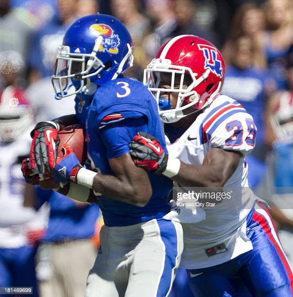 Kansas Jayhawks running back Tony Pierson catches a pass in front of Louisiana Tech Bulldogs defensive back Xavier Woods during the fourth quarter at...